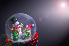 Christmas snow globe with snowman isolated on black gradient background Royalty Free Stock Photo