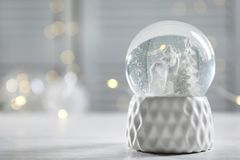 Christmas snow globe on table. Space for text royalty free stock photo