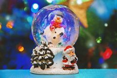 Christmas snow globe with Christmas tree lights background stock photos