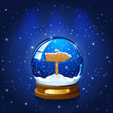 Christmas Snow globe with wooden sign Stock Image