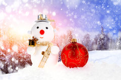 Christmas snow men and christmas ball Stock Image