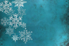 Christmas snowfalkes on blue textured background Royalty Free Stock Image