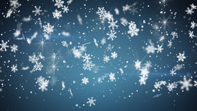 Christmas snowfall on blue background Stock Images
