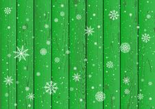 Snowfall and green wood background stock illustration