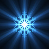 Christmas snowflake blue light flare Royalty Free Stock Photography