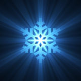 Christmas snowflake blue light flare Royalty Free Stock Photos