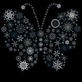 Christmas snowflake-butterfly. White-blue christmas snowflake-butterfly on black stock illustration