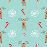 Christmas snowflake candy cane, deer wearing red santa hat. Seamless Pattern Decoration. Wrapping paper, textile template. Blue ba. Ckground. Flat design. Vector Royalty Free Stock Images
