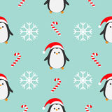 Christmas snowflake candy cane, penguin wearing red santa hat, scarf. Seamless Pattern Decoration. Wrapping paper, textile templat Royalty Free Stock Image