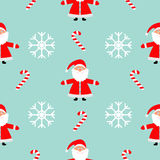 Christmas snowflake candy cane, Santa Claus wearing red hat. Seamless Pattern Decoration. Wrapping paper, textile template. Blue b. Ackground. Flat design Stock Photos