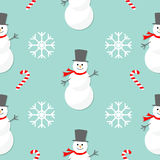 Christmas snowflake candy cane, smowman wearing hat and scarf. Seamless Pattern Decoration. Wrapping paper, textile template. Blue. Background. Flat design Royalty Free Stock Photography