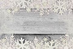 Christmas snowflake double border with snow frame on white wood Stock Images