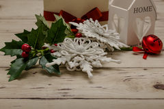 Christmas snowflake figurines with green branches decoration Royalty Free Stock Images