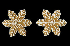 Christmas snowflake gingerbread cookies. Gingerbread snowflake cookies isolated on black background Royalty Free Stock Photography