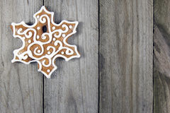 Christmas snowflake gingerbread on wooden background Royalty Free Stock Photo