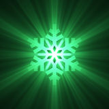 Christmas snowflake green light flare Stock Photography