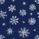 Christmas snowflake hand drawing seamless pattern on dark blue. Royalty Free Stock Photo
