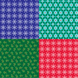 Christmas snowflake and holly background patterns Royalty Free Stock Photography