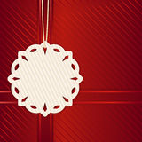Christmas snowflake label on red Royalty Free Stock Photography