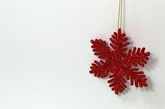 Christmas snowflake ornament. A red christmas snowflake shaped ornament Royalty Free Stock Photos