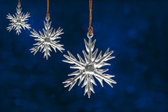 Christmas snowflake ornaments on blue Stock Photography