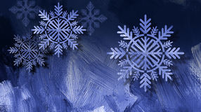 Christmas snowflake ornaments on blue brushstroke background. Graphic composition of holiday snowflake ornaments on a blue brush stroke textured background for Stock Photos