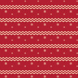 Christmas snowflake pattern and zigzag lines on red background. Festive theme Stock Photo