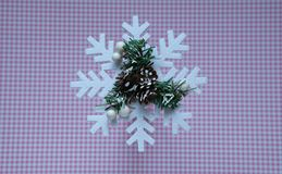 Christmas snowflake on pink polka dot background, top view stock photography