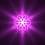 Christmas snowflake purple light flare Stock Images