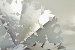 Christmas snowflake. The silver snowflake  cut out of paper on snow background Royalty Free Stock Images