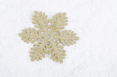 The christmas Snowflake on snow Stock Photography