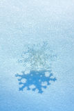 Christmas snowflake on snow Stock Photography