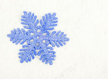 The christmas Snowflake on snow Stock Photography