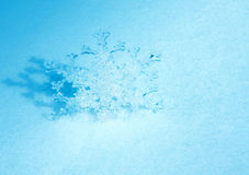 Christmas snowflake on snow Royalty Free Stock Image