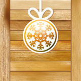 Christmas snowflake on a wood box. + EPS8. Orange christmas snowflake on a wood background. + EPS8 vector file Stock Illustration