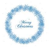Christmas snowflake wreath `Merry Christmas`. Christmas snowflake wreath and greeting word `Merry Christmas` on white background Stock Photo