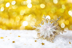 Christmas  snowflake  on yellow  background. Stock Photo
