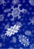 Christmas  snowflakes. Arctic  background  blizzard  blue  blur  card  chilly  christmas  claus  cold  color  cool  crystal  december  fall  falling  father Stock Photos