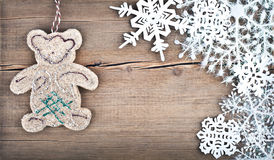 Christmas snowflakes and bear toy Royalty Free Stock Images