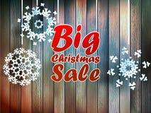 Christmas snowflakes with big sale. Christmas snowflakes with big sale over wooden background. EPS 10 Royalty Free Stock Photography