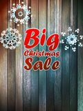 Christmas snowflakes with big sale. Christmas snowflakes with big sale over wooden background. EPS 10 Royalty Free Stock Images