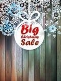 Christmas snowflakes with big sale. Christmas snowflakes with big sale over wooden background. EPS 10 Stock Photography