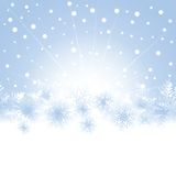 Christmas snowflakes on blue background of the greeting card. Royalty Free Stock Photo