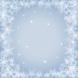 Christmas snowflakes on blue background. Royalty Free Stock Photos