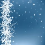 Christmas snowflakes on blue background. Royalty Free Stock Images