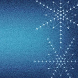 Christmas snowflakes on a blue jeans texture Royalty Free Stock Photo