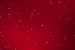 Christmas snowflakes falling down snow flowing from top on red gradient background, winter holiday xmas Stock Image