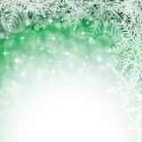 Christmas snowflakes on green background. Royalty Free Stock Photography