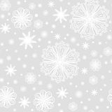 Christmas snowflakes on grey seamless pattern Stock Photography
