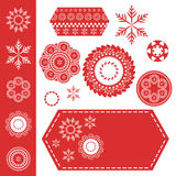 Christmas snowflakes or lace design elements on red tag with white stiches royalty free stock image